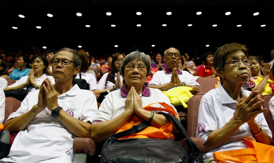 People offer prayers during a mass prayer for the missing Malaysia Airlines Flight MH370, in Kuala Lumpur, Malaysia, Sunday, April 6, 2014. (AP / Lai Seng Sin)