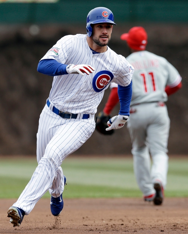 Chicago Cubs' Ryan Kalish runs to third a