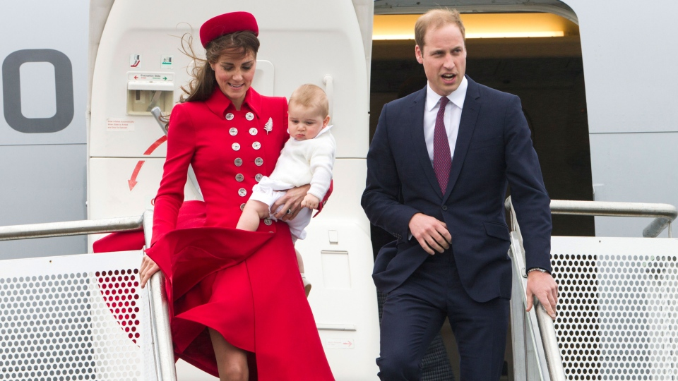 Britain's Prince William and Catherine, Duchess of Cambridge with Prince George arrive for their visit to New Zealand at the International Airport, in Wellington, New Zealand, Monday, April 7, 2014. (SNPA / David Rowland)