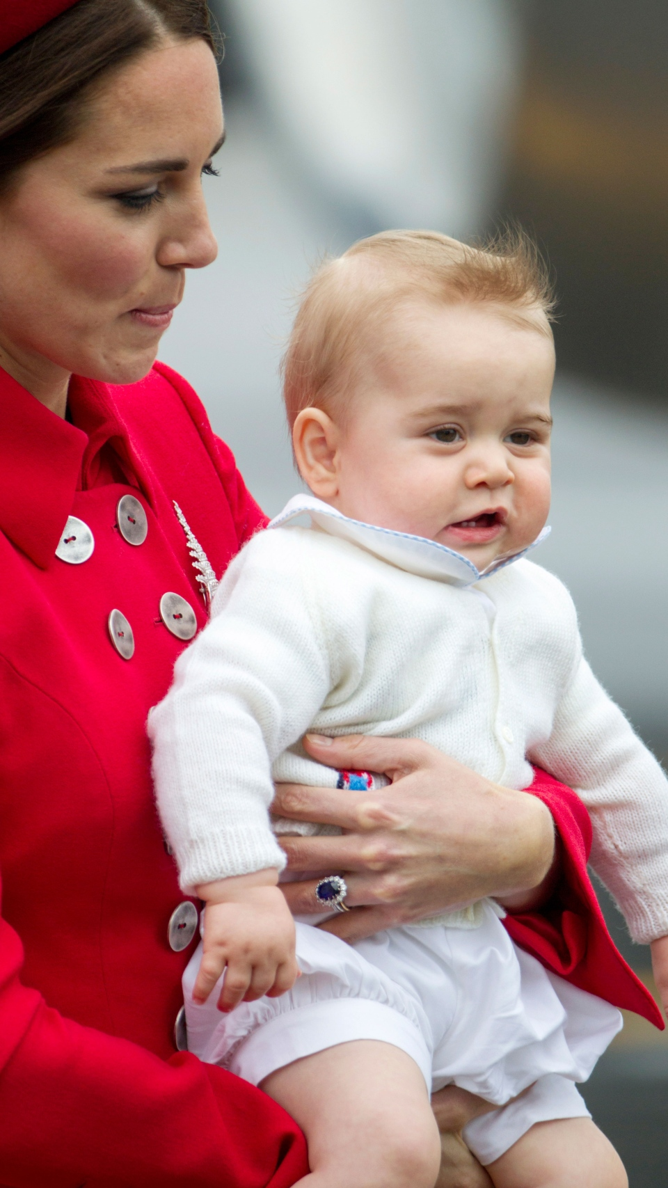 Catherine, Duchess of Cambridge holds Prince George while arriving for their visit to New Zealand at the International Airport, in Wellington, New Zealand, Monday, April 7, 2014. (SNPA /  David Rowland)