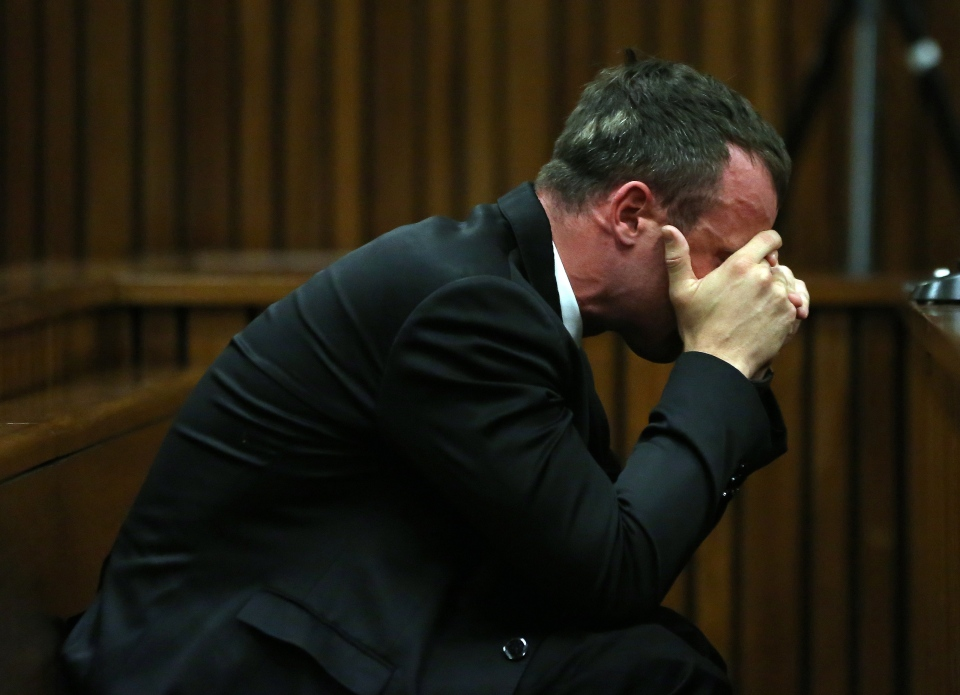 Oscar Pistorius reacts as he listens to evidence by a pathologist in court in Pretoria, South Africa Monday, April 7, 2014. Pistorius is charged with murder in the shooting death of his girlfriend Reeva Steenkamp on Valentine's Day 2013. (AP Photo/Themba Hadebe, Pool)