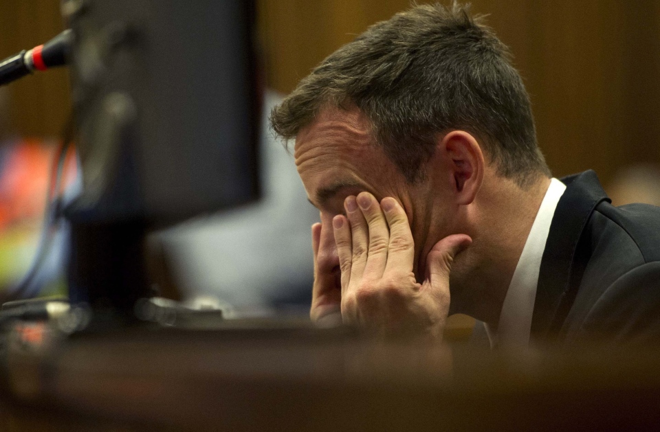 Oscar Pistorius reacts as he listens to evidence by a pathologist in court in Pretoria, South Africa, Monday, April 7, 2014. (AP/Deaan Vivier)