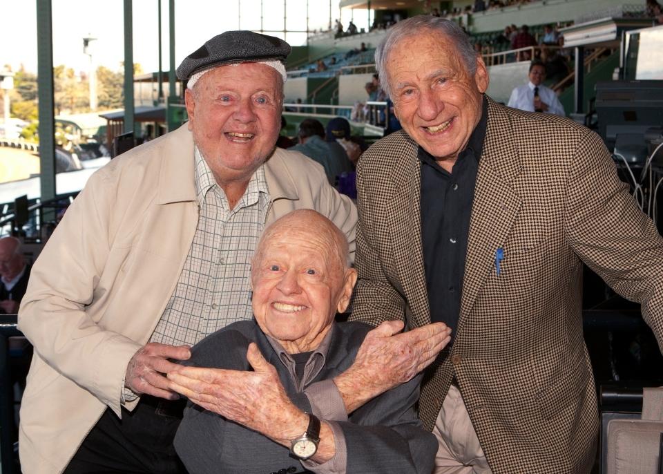 Entertainment icons Dick Van Patten, left, and Mel Brooks flank Mickey Rooney at Santa Anita Park, in Arcadia, Calif., Sunday, March 30, 2014. (AP / Benoit)