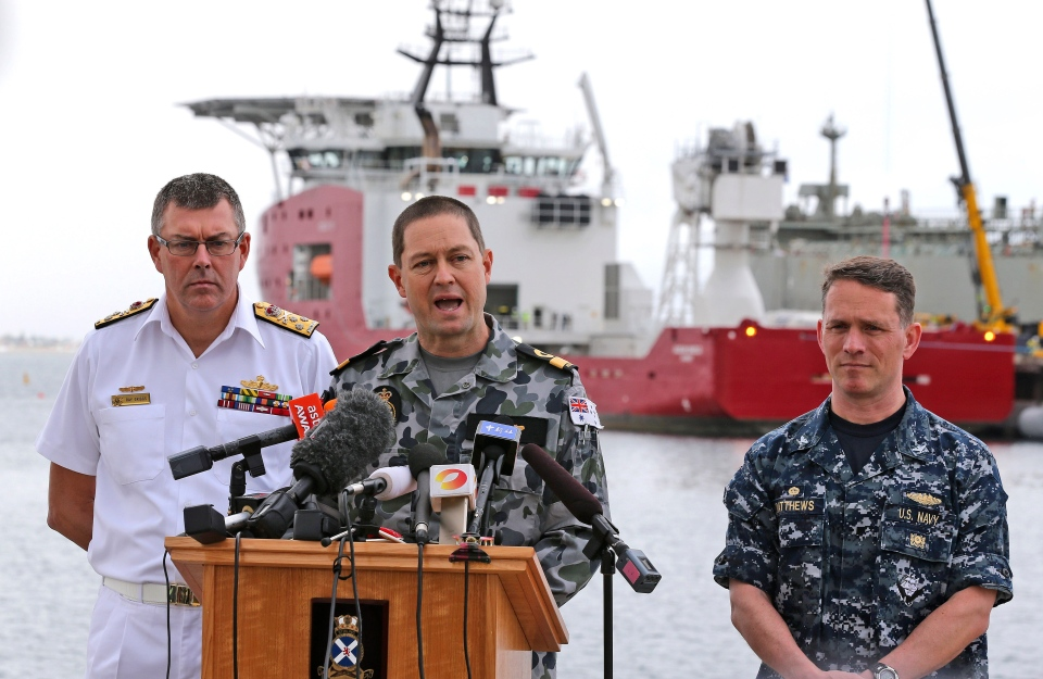 Royal Australian Navy Commodore Peter Leavy, centre, is accompanied by U.S. Navy Captain Mark Matthews, right, and Chief of the Royal Australian Navy Vice Admiral Ray Griggs at naval base HMAS Stirling on March 30, 2014. (AP / Rob Griffith)