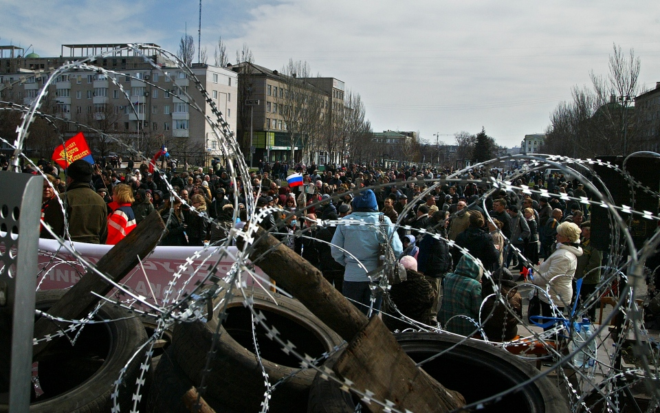 Activists gather in front of a barricade at the regional administration building in in Donetsk, Ukraine, Monday, April 7, 2014. (AP / Alexander Ermochenko)