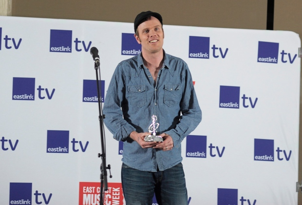 Nova Scotia's Dave Gunning holds his Songwriter of the Year trophy at the East Coast Music Awards in Charlottetown, P.E.I. on April 6, 2014. (THE CANADIAN PRESS/Nathan Rochford)