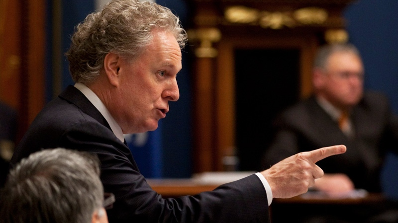Quebec Premier Jean Charest responds to Opposition questions over a possible inquiry in the construction industry at the legislature in Quebec City on Tuesday, Oct. 18, 2011. (Jacques Boissinot / THE CANADIAN PRESS)