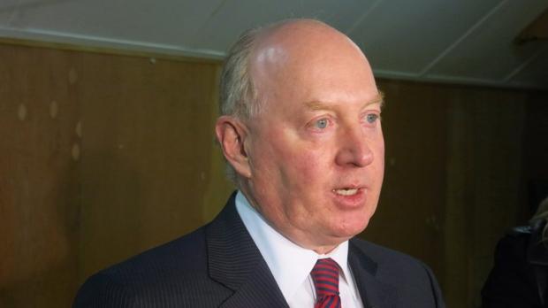 Ken Hughes speaks to reporters in Calgary