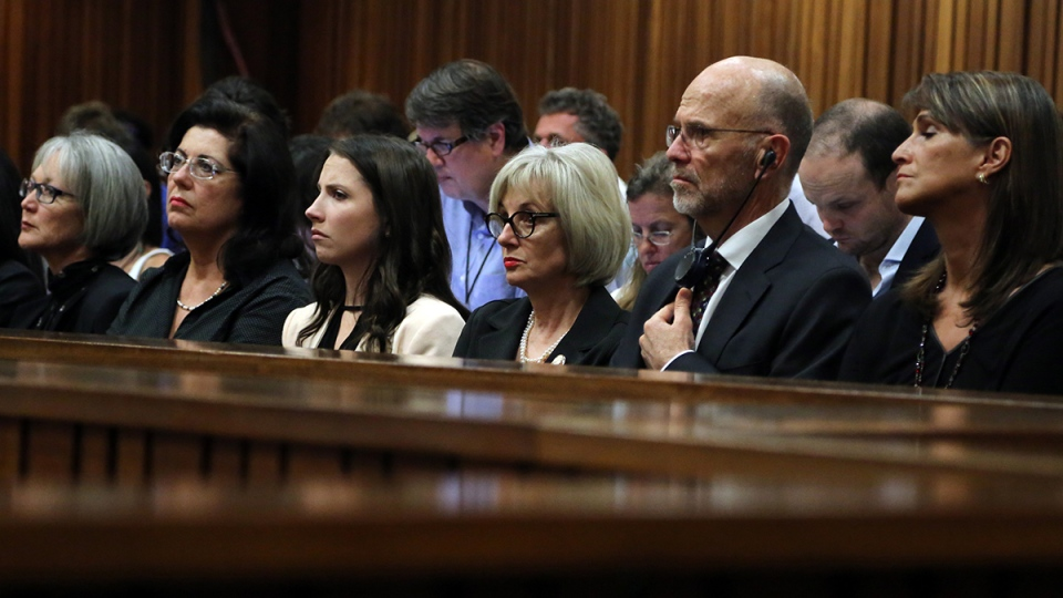 Family members of Oscar Pistorius, third from left to right, sister Aimee, aunt Lois and uncle, Arnold listen as Pistorius gives evidence in court in Pretoria, South Africa, Monday, April 7, 2014. (AP / Themba Hadebe)