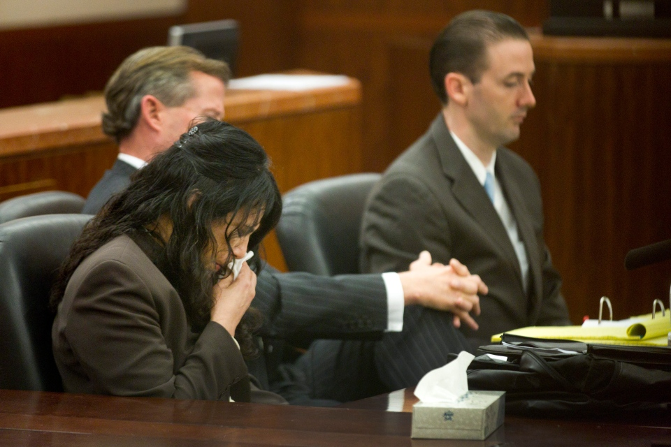 Ana Lilia Trujillo, left, reacts to hearing a 911 call during her trial Tuesday, April 1, 2014, in Houston. Trujillo, 45, is charged with murder, accused of killing her 59-year-old boyfriend, Alf Stefan Andersson with the heel of a stiletto shoe. (AP Photo/Houston Chronicle, Brett Coomer)