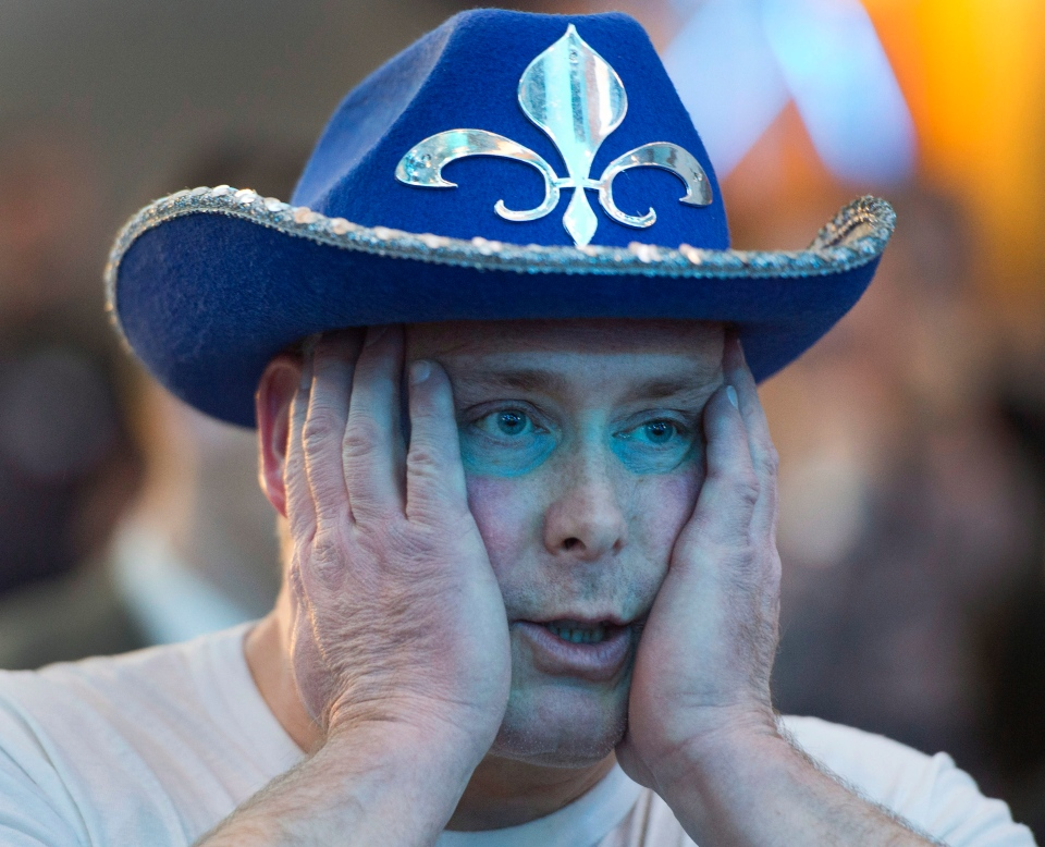 A Parti Quebecois supporter reacts as he watches election results at the party's reception in Montreal, Monday, April 7, 2014. (Ryan Remiorz / THE CANADIAN PRESS)