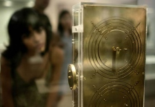 A visitor looks at a model replica of an ancient astronomical calculator, known as the Antikythera Mechanism, at the National Archaeological Museum of Athens, Wednesday, July 30, 2008. (AP / Losmi Chobi)
