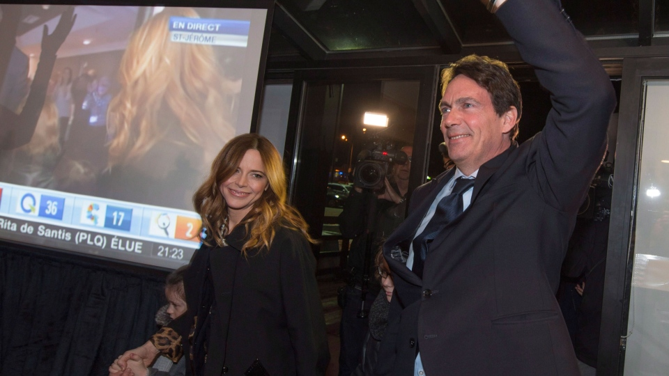 Pierre Karl Peladeau arrives at his election headquarters with his wife Julie Snyder and children and waves to his supporters after winning his seat in the riding of Saint-Jerome north of Montreal on Monday, April 7, 2014.  (Peter McCabe / THE CANADIAN PRESS)