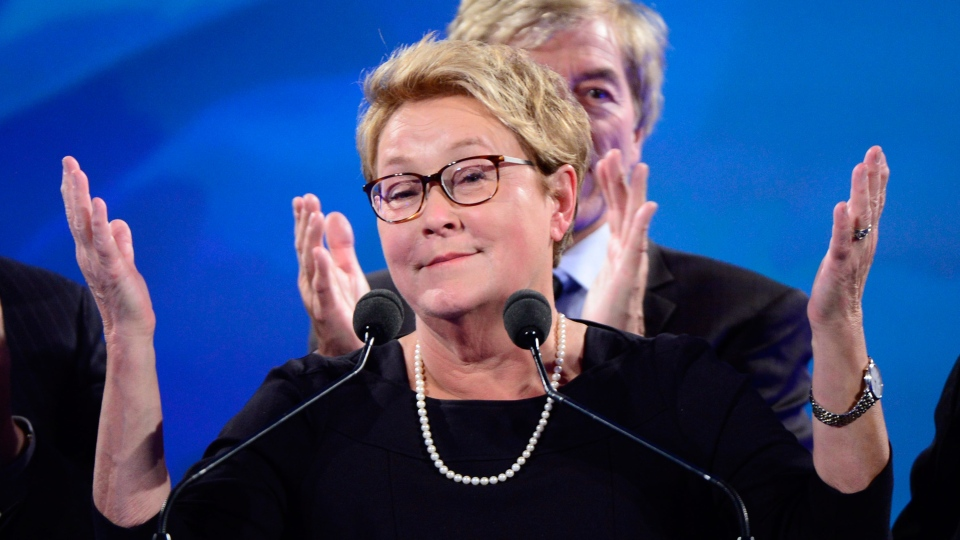 Parti Quebecois leader Pauline Marois acknowledges the crowd at the party's election headquarters on Monday, April 7, 2014 in Montreal, Que. (Ryan Remiorz / THE CANADIAN PRESS)
