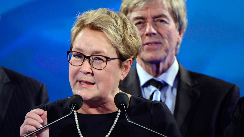 Husband Claude Blanchet looks on as PQ leader Pauline Marois speaks after her party's defeat in the provincial election Monday April 7, 2014 in Montreal. (Paul Chiasson / THE CANADIAN PRESS)