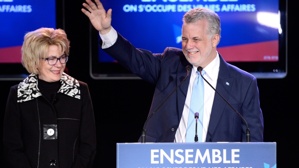 Quebec Liberal leader Philippe Couillard and his wife Suzanne Pilote take the stage after winning the provincial election Monday April 7, 2014 in St-Felicien, Que. ( Jacques Boissinot / THE CANADIAN PRESS)