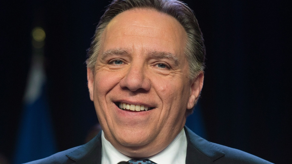 Coalition Avenir Quebec Leader Francois Legault smiles as he speaks to supporters at the CAQ's election headquarters in Repentigny, Que., Monday, April 7, 2014. (Graham Hughes / THE CANADIAN PRESS)