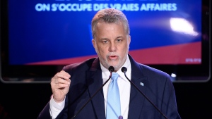 Quebec Liberal Leader Philippe Couillard takes the stage after winning the provincial election, in St-Felicien, Que., Monday, April 7, 2014 (Jacques Boissinot / THE CANADIAN PRESS)