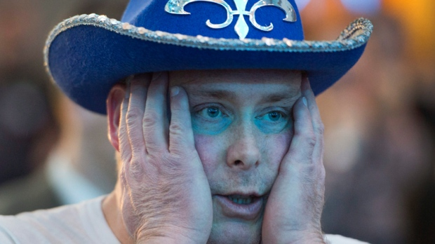 Parti Quebecois supporter watches election results