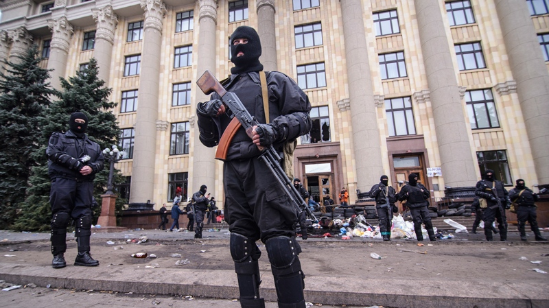 Members of a Special police unit guard the regional administration building in Kharkiv, Ukraine, Tuesday, April 8, 2014. (AP Photo/Olga Ivashchenko)
