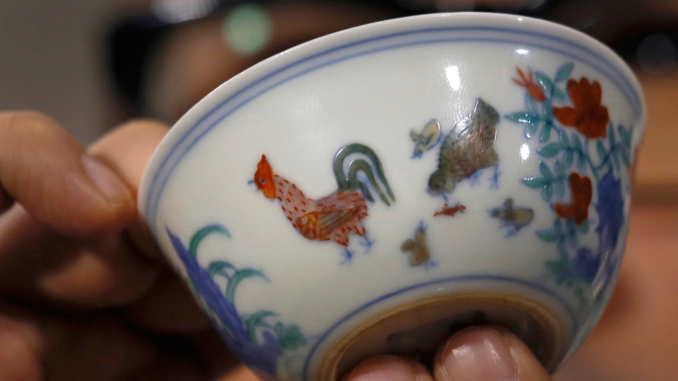 The Meiyintang 'Chicken Cup' from the Chinese Ming Dynasty (1368-1644) is displayed during a press conference in Hong Kong, Tuesday, April 8, 2014. (AP / Vincent Yu)