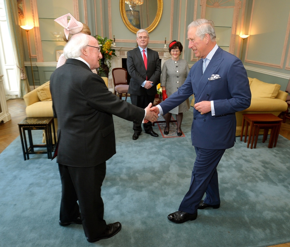 Irish President Michael Higgins shakes hands with the Prince of Wales at the Irish Embassy in central London, Tuesday April 8, 2014. (AP Photo / John Stillwell)