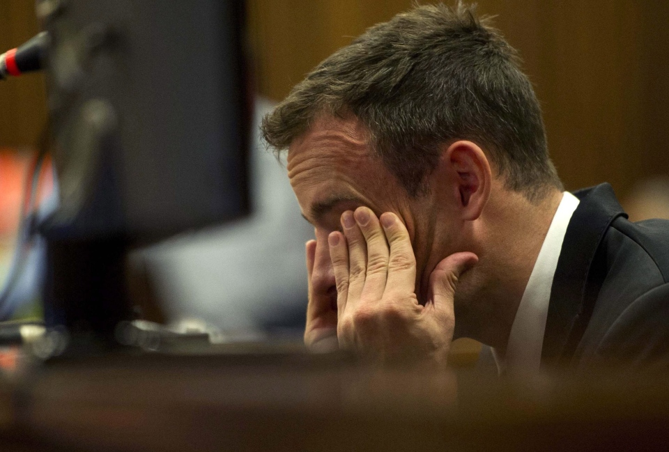Oscar Pistorius reacts as he listens to evidence by a pathologist in court in Pretoria, South Africa, Monday, April 7, 2014. Pistorius testified Tuesday about moments before shooting. (AP / Deaan Vivier)