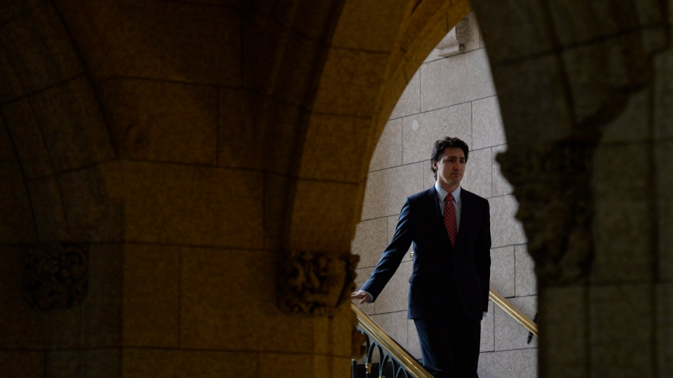 Liberal leader Justin Trudeau walks down stairs as he makes his way to the foyer of the House of Commons on Parliament Hill in Ottawa, Tuesday April 8, 2014. (Adrian Wyld / HE CANADIAN PRESS)