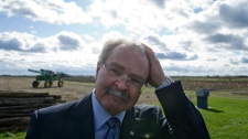 Agriculture Minister Gerry Ritz leaves an announcement regarding the introduction of a bill to eliminate the Canadian Wheat Board during a press conference at a farm in Ottawa on Tuesday, Oct. 18, 2011. (Sean Kilpatrick / THE CANADIAN PRESS)