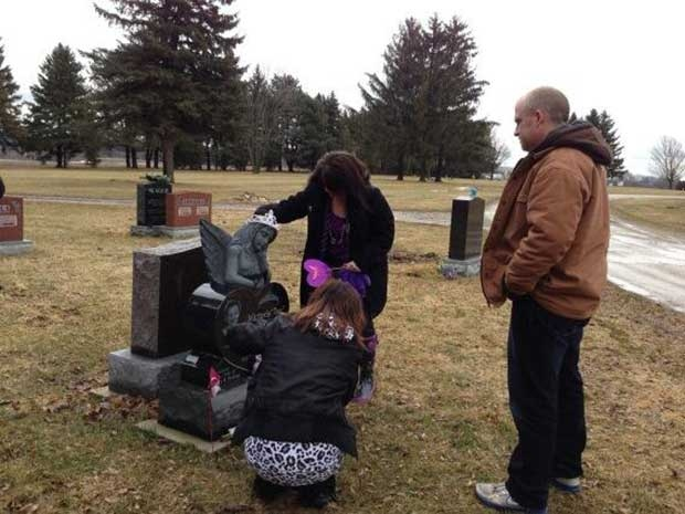 Rodney Stafford, right, was among those visiting the grave of his daughter Victoria Stafford on the five-year-anniversary of her disappearance in Woodstock, Ont. on Tuesday, April 8, 2014. (Nick Paparella / CTV London)