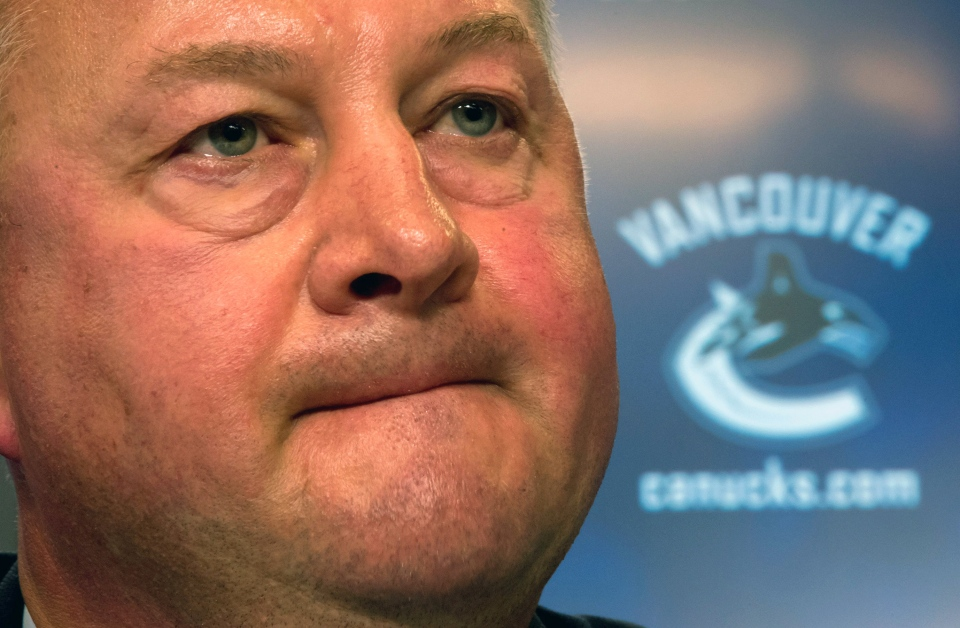 Vancouver Canucks president and general manager Mike Gillis addresses reporters in Vancouver, British Columbia on May 22, 2013. . (Darryl Dyck  / THE CANADIAN PRESS)