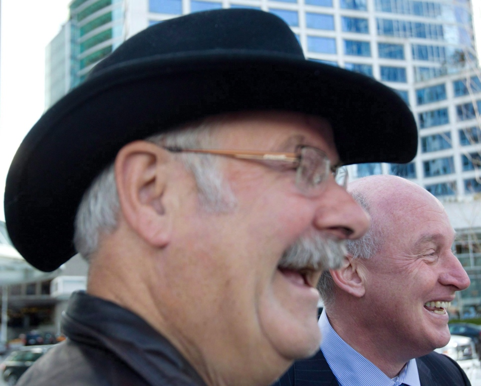 British Columbia NDP leadership candidate Mike Farnworth, right, and former B.C. premier Mike Harcourt share a laugh during a news conference in Vancouver, B.C. (Darryl Dyck / THE CANADIAN PRESS)