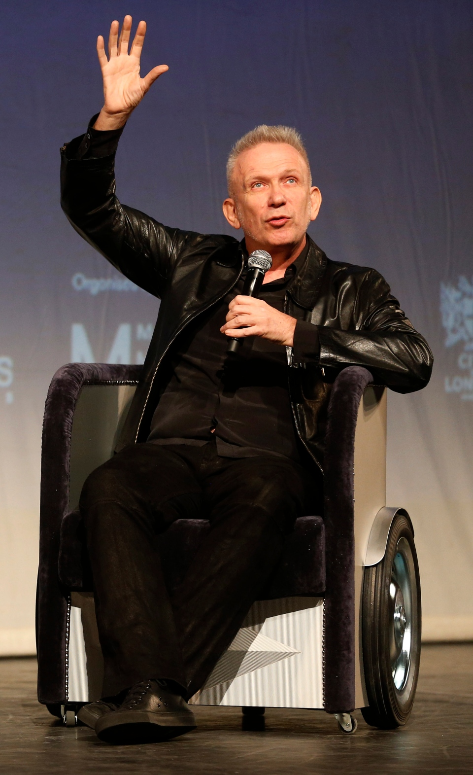 French couturier Jean Paul Gaultier gestures as he speaks to the media in a Q&A session during the launch his exhibition 'The Fashion World of Jean Paul Gaultier : From the Sidewalk to the Catwalk' at the Barbican Art Gallery in London, Tuesday, April 8, 2014. (AP / Sang Tan)