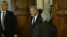 Premier Jean Charest stepped out of an early morning caucus meeting, then led his inner cabinet to a second meeting in his office (Oct. 17, 2011)