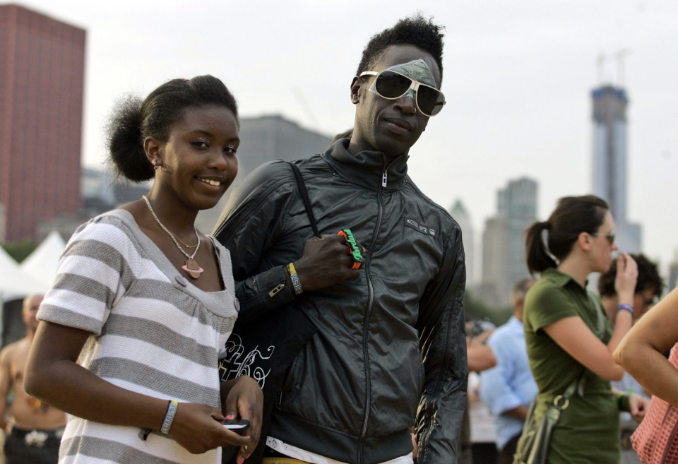 Saul Williams and his daughter, Saturn, pose for a photo at Lollapalooza in Chicago's Grant Park on Sunday, Aug. 3, 2008 (AP/Russel A. Daniels)