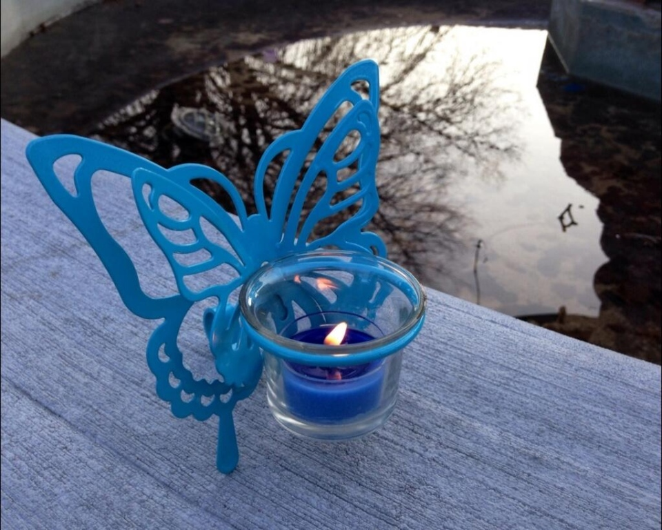 Butterflies, candles and balloons, all in purple - Tori Stafford's favourite colour - were at a vigil held in her honour, five years after her disappearance, in Woodstock, Ont. on Tuesday, April 8, 2014. (Chuck Dickson / CTV London)