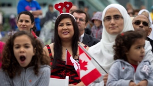 A group of immigrants look on before taking the oath of citizenship during a special Canada Day citizenship ceremony for 60 people in Vancouver, B.C., on Sunday July 1, 2012. (Daryl Dyck/The Canadian Press)