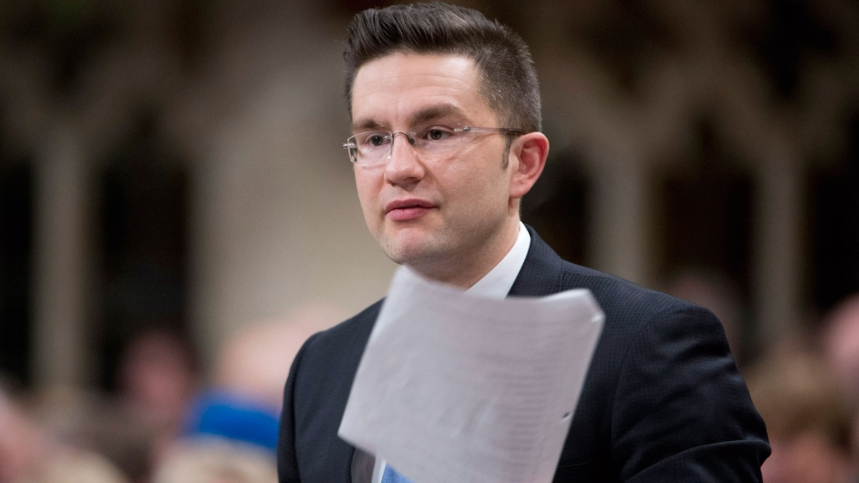 Minister of State (Democratic Reform) Pierre Poilievre responds to a question during Question Period in the House of Commons Tuesday April 8, 2014 in Ottawa. (Adrain Wyld / THE CANADIAN PRESS)