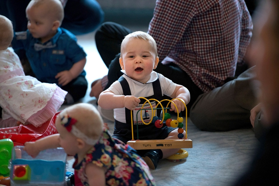 Prince George, centre, plays during a visit to Plunket nurse and parents group at Government House in Wellington, New Zealand, Wednesday, April 9, 2014. (AP / Marty Melville)
