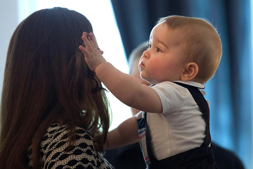 The Duchess of Cambridge holds Prince George during a visit to Plunket nurse and parents group at Government House in Wellington, New Zealand, Wednesday, April 9, 2014. (AP / Marty Melville)