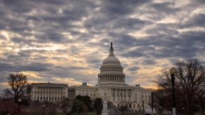 In this April 3, 2014, photo, clouds hang over the Capitol in Washington. (AP Photo/J. Scott Applewhite)
