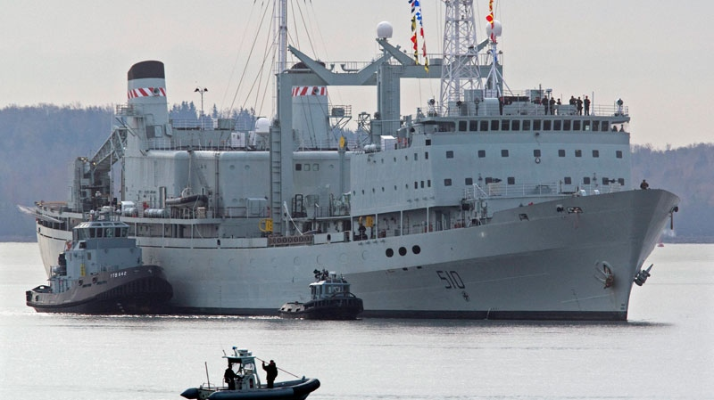 HMCS Preserver, one of Canada's operational support ships, designed to carry large amounts of fuel, provisions, and dry stores during naval operations, is pushed by tugs in Halifax harbour on Wednesday, Oct. 19, 2011.  (Andrew Vaughan / THE CANADIAN PRESS)