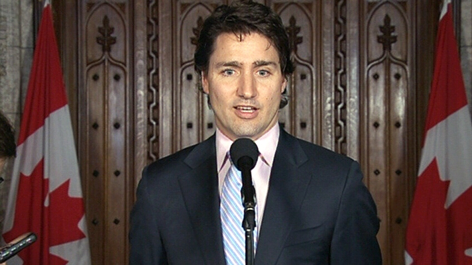 Liberal Leader Justin Trudeau speaks to reporters about the Fair Elections Act on Parliament Hill in Ottawa on Wednesday, April 9, 2014.