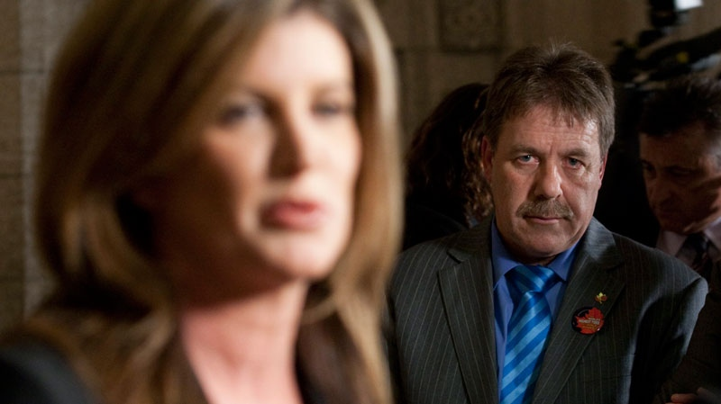 NDP critic and Nova Scotia MP Peter Stoffer listens to Minister of Public Works Rona Ambrose speak about the shipbuilding contract awarded to Halifax and Vancouver shipyards on Parliament Hill in Ottawa, ON Wednesday Oct. 19, 2011. (Adrian Wyld / THE CANADIAN PRESS)