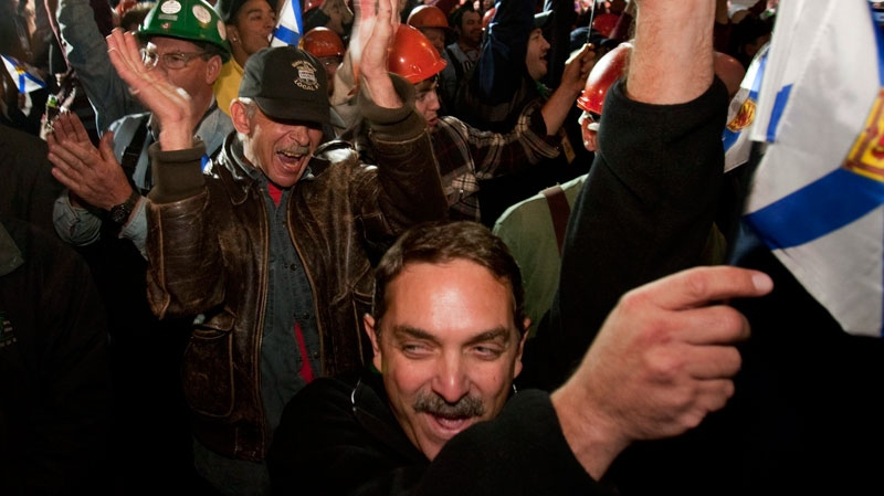 Workers react after the announcement that Halifax Shipyard, owned by Irving Shipbuilding, is getting the $25 billion contract to build 21 Canadian combat ships, in Halifax on Wednesday, Oct. 19, 2011 (Andrew Vaughan / THE CANADIAN PRESS)