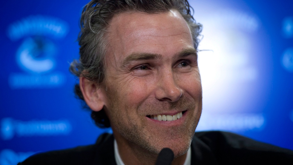 Trevor Linden smiles as he speaks at a press conference in Vancouver on Wednesday, April 9, 2014. (Jonathan Hayward / THE CANADIAN PRESS)