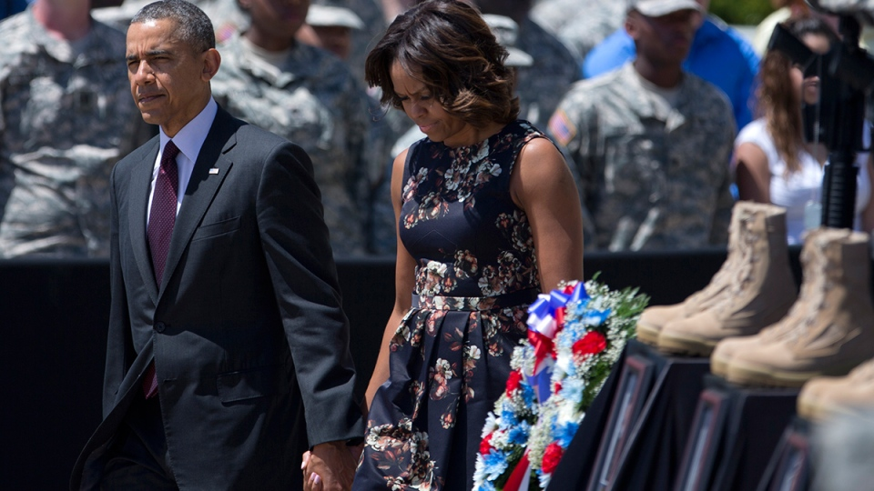 U.S. President Barack Obama and first lady Michelle Obama arrive for a memorial ceremony at Fort Hood Texas on Wednesday, April 9, 2014. (AP / Carolyn Kaster)