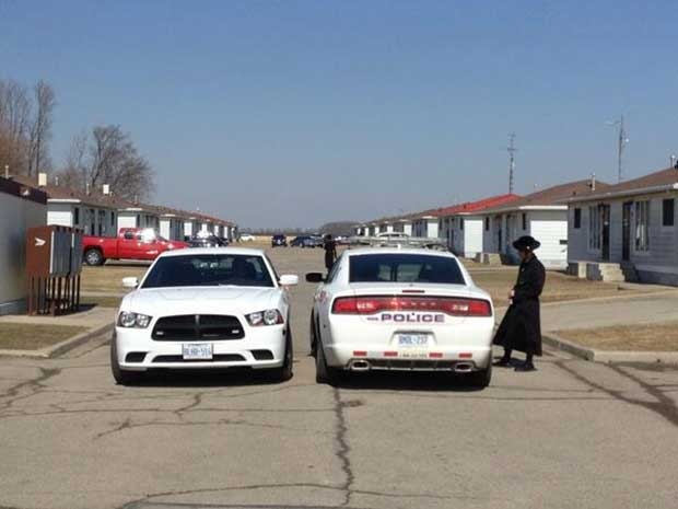 Chatham police cruisers are seen near the homes of Lev Tahor members in Chatham, Ont. on Wednesday, April 2, 2014. (Christie Bezaire / CTV Windsor)