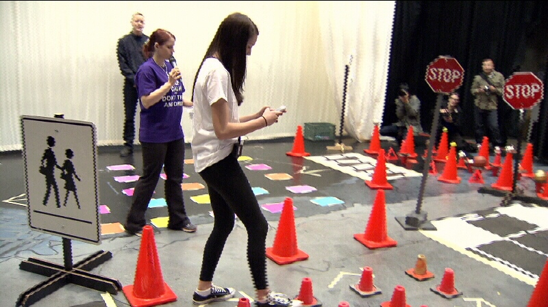 students stumble through distracted driving obstacle