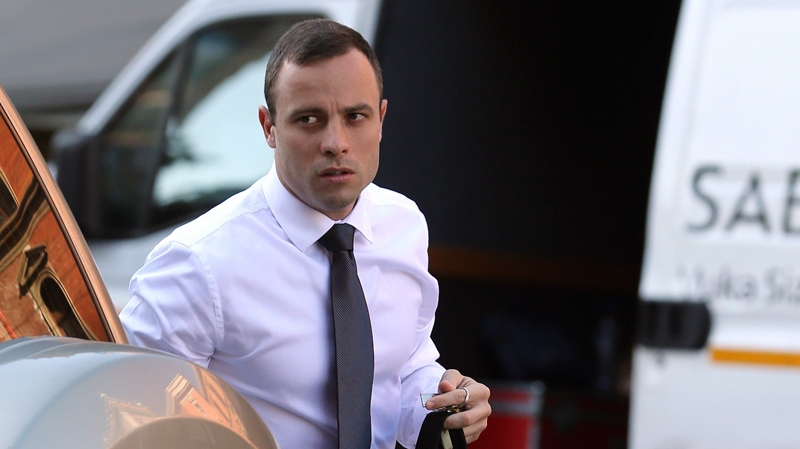 Oscar Pistorius arrives at the high court in Pretoria, South Africa, Thursday, April 10, 2014. (AP / Themba Hadebe)